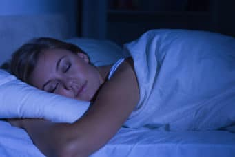 Woman getting restful sleep after getting her insomnia treated