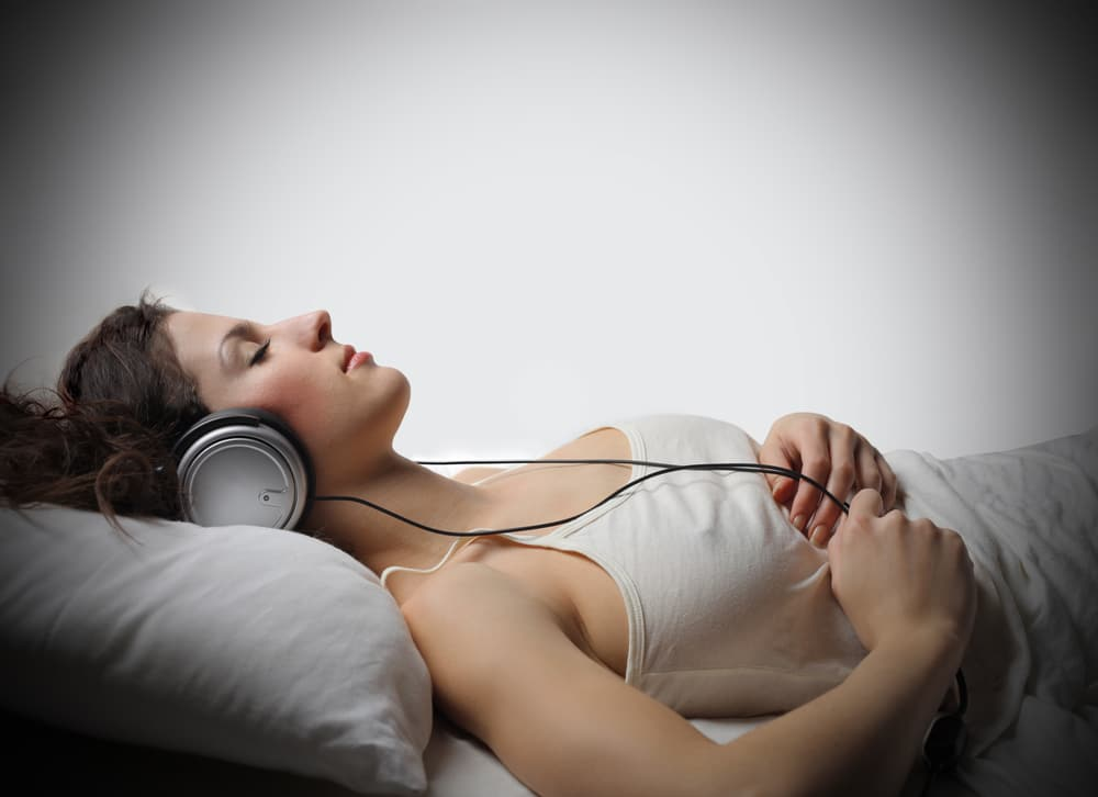 Listening to calm music to help relax and fall asleep