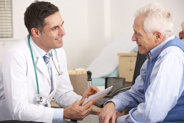 man talking to doctor about insomnia treatment