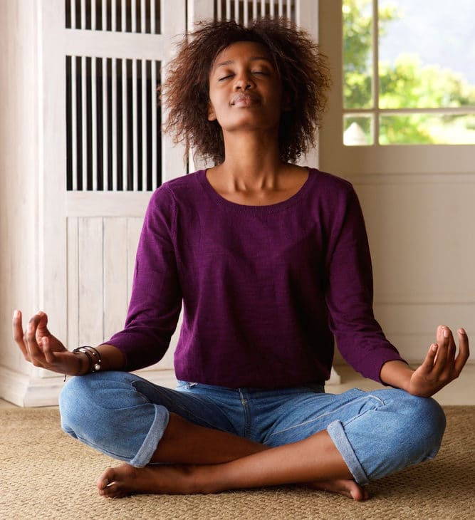 African american woman practicing mindfulness meditation for better sleep