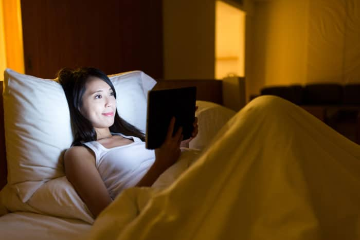 Using a computer tablet in bed can make it hard to fall asleep