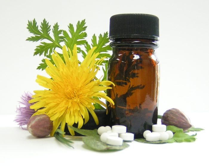 natural sleeping aids tablets next to herbal plants