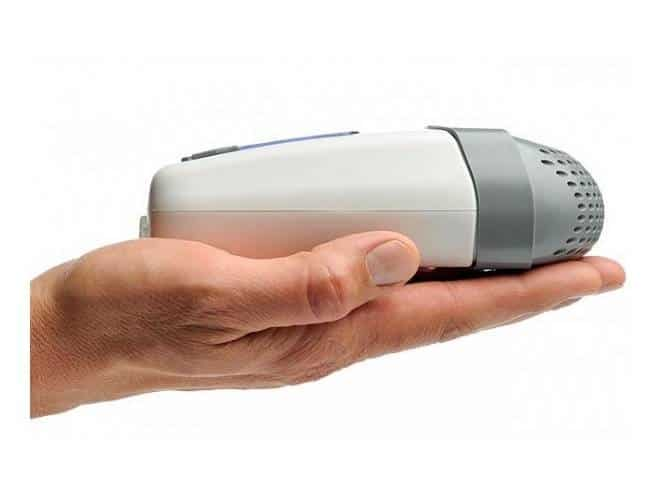 portable CPAP machine in the palm of a hand