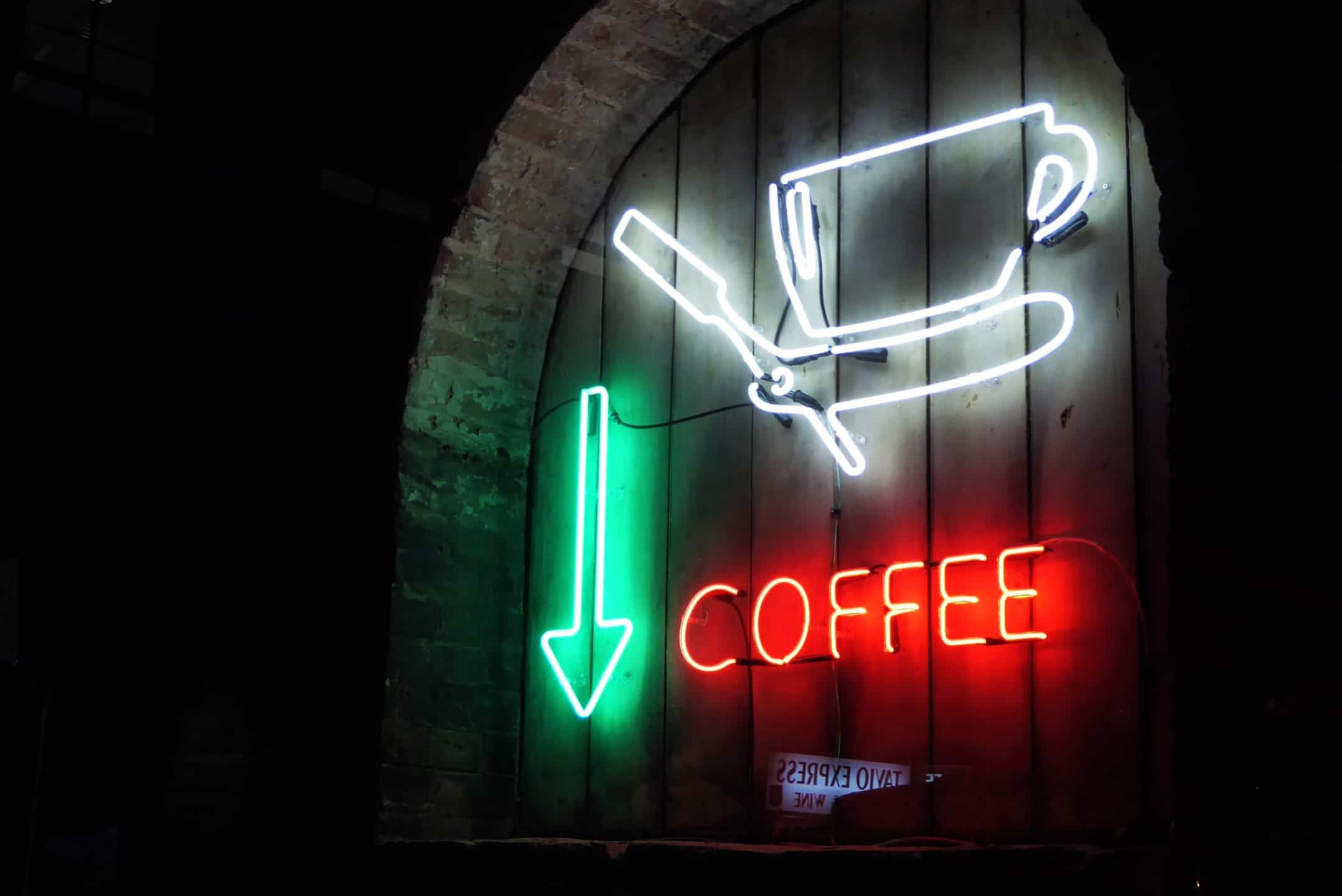 coffee cup sign on a coffee shop open for people to get a late night caffeine fix