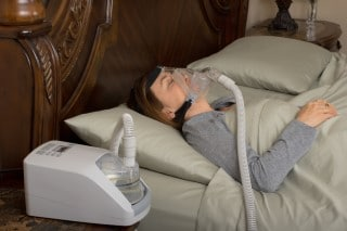 women with sleep apnea sleeping with CPAP mask on