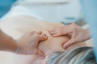 picture of person getting back massage for pain management