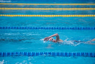 picture of person swimming in pool for pain management