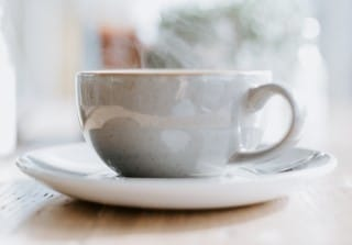 photo of cup holding steaming milk