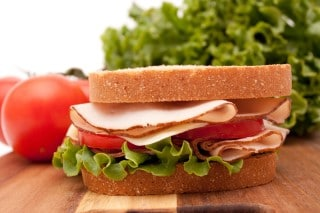 photo of a light turkey sandwich for lunch to avoid falling asleep at work