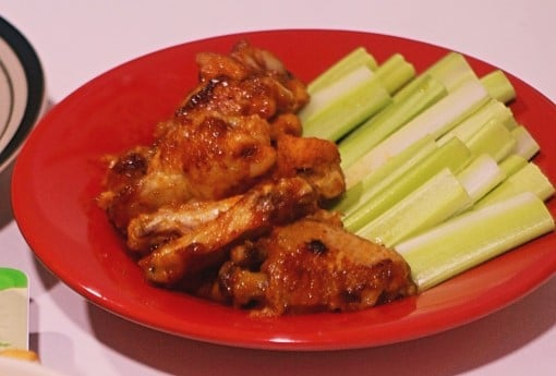 plate with spicy chicken wings which is one of the foods to avoid when having insomnia