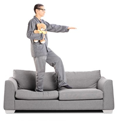 man walking on couch who needs a sleepwalking prevention device