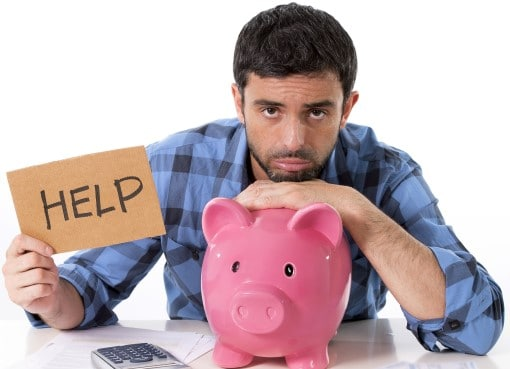man with piggy bank and help sign