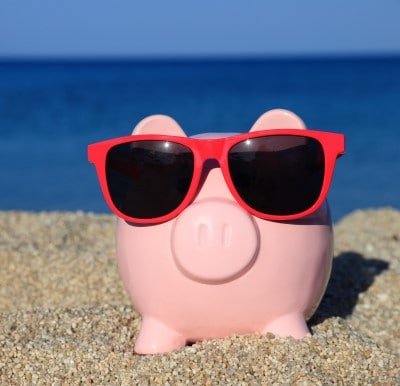 piggy bank on the beach in the sunshine