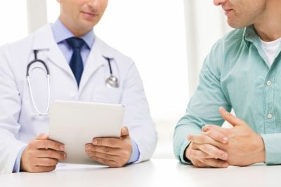 Man reviewing meds with doctor
