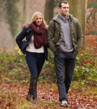 Couple taking a walk in the woods