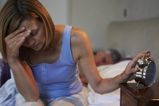 Women awake in bed from machine noise,one of many common cpap spouse complaints