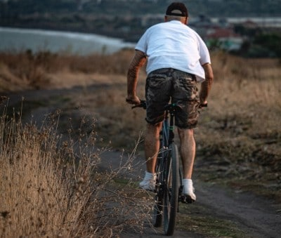 man riding bike for exercise to fight inflammation similar to turmeric for sleep apnea