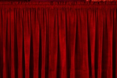 red heavy drapes covering window