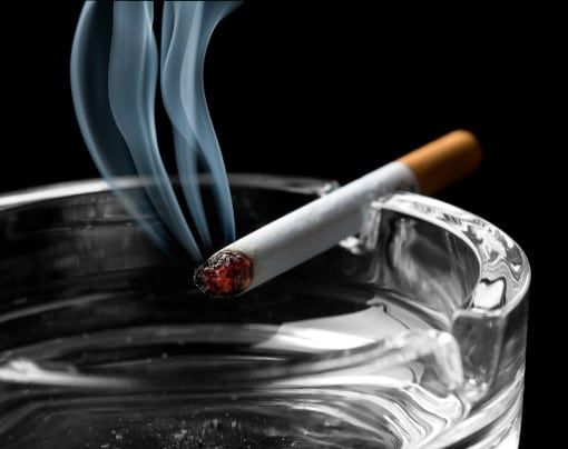 cigarette on ashtray from person waking up in the middle of the night to smoke