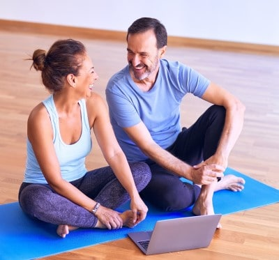 couple stretching before bedtime which can help if CPAP is stressing you out