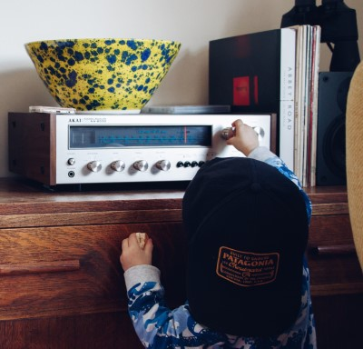 photo of kid turning radio on for bedtime music