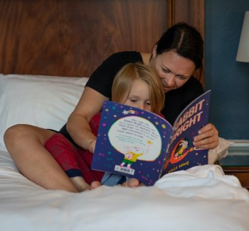 photo of parent reading story to kid