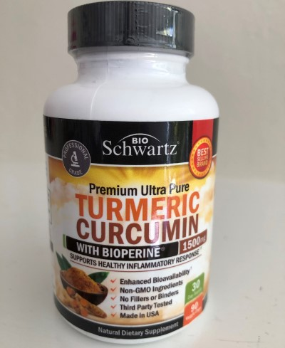 photo of a bottle containing turmeric curcumin supplement for insomnia