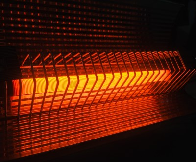 photo of electric space heater to warm up the room if you're too cold to sleep