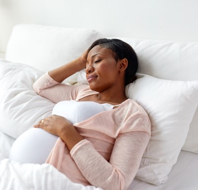photo of woman getting extra sleep to help her stay awake at work while pregnant
