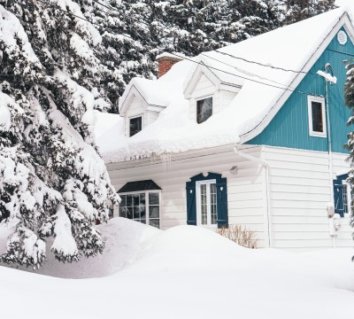 photo of house covered with snow