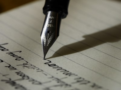 photo of writing a letter to someone which can help if too lonely to sleep