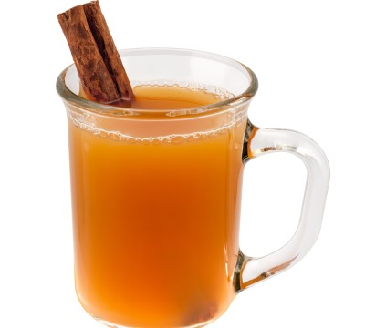 photo of cup with warm cider which is a comforting alternative to hot chocolate before bed