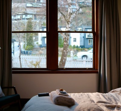 photo of bedroom window that need sound insulation to keep car noise from waking you up
