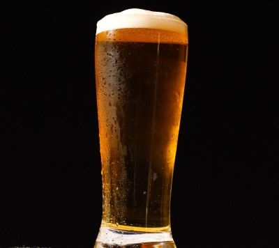 photo of person glass of beer to have before bed