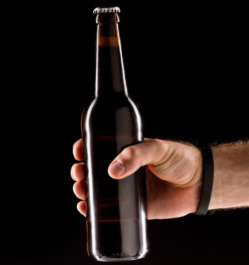 photo of person holding a beer to have before bed