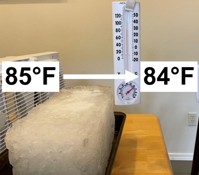 photo of block ice in front of a fan with a thermometer