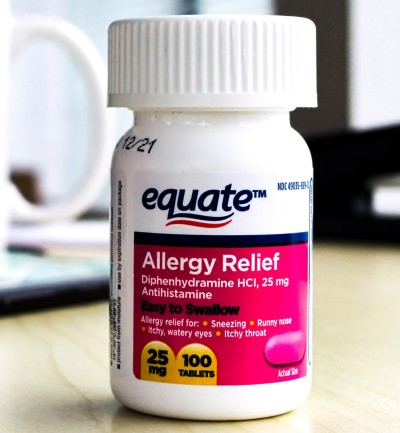 Photo of allergy medication that may help when sleeping with a dog
